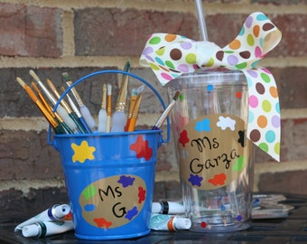Personalized Art Teacher gift - Acrylic tumbler and metal pail brush holder with vinyl colored palette, teacher name, and paint splats