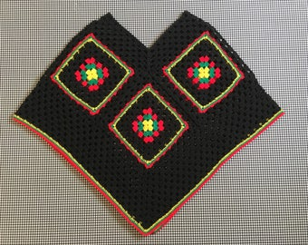 Hand crocheteed, afghan square, poncho, in black, with red, green, and yellow