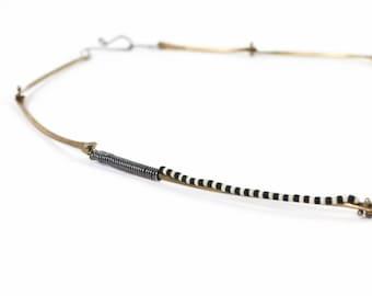Brass Kinetic Zebra Necklace