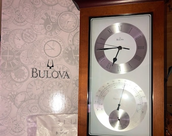Bulova hanging clock with thermometer 17inx10in.. new in box