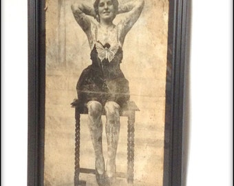 Aged reproduction Victorian Tattooed Lady print in frame.