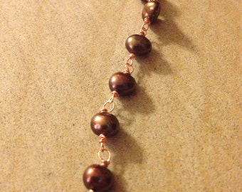 Brown/copper pearl necklace