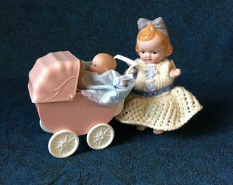 Vintage Miniature Bisque Baby Dolls and Carriage