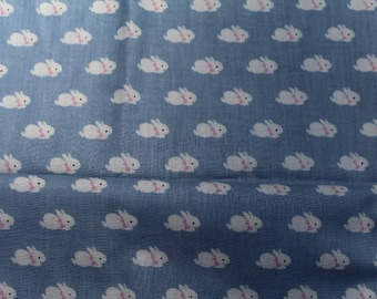 Nursery Rhymes by Hoffman California Fabrics Blue Bunnies with Pink Bows Fabric