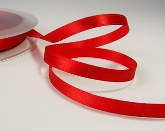 Roll of 25 meters of 6 mm Red satin ribbon.