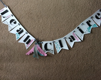 Name banner with feather accents