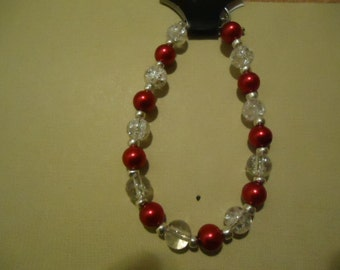 Item # 3002 Red Glass and Clear Glass Bead Bracelet