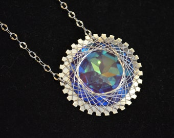 Necklace, sterling silver and swarovski crystal wire wrapped necklace
