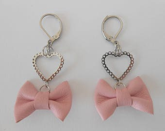 Pink earrings year steel with leather knots