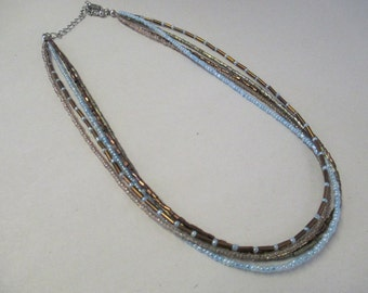 K Vintage blue and copper seed beaded necklace with silver tone chain closure not marked  19 inch