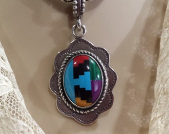 Sterling silver native American inlaid assorted stones pendant