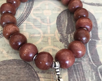 Wood bead bracelet with violin/cello charm