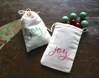 Christmas gift bags, set of 10 holiday favor bags, JOY script in red and green, gift card holder, hand stamped cotton bags, cloth favor bags