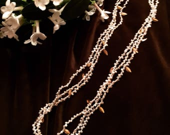 White freshwater pearl multistrand necklace with gold leaves and accents