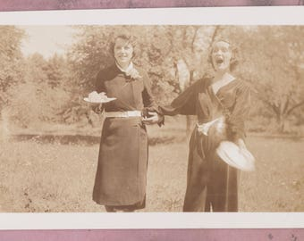 Vintage Photo, Excited Woman Yells and Throws Flower, Oddity, Vernacular, Candid, Strange, Romper, Lilies, Fashion, Black Dress, Action Shot