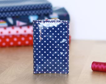 Navy blue card holder with white polka dots
