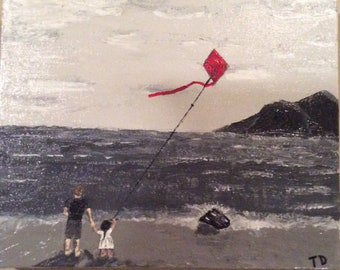 Dad and daughter fly a kite