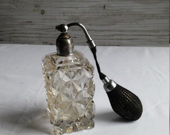 Vintage Czechoslovakian Crystal Perfume Bottle with Attached Black Atomizer.
