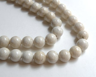Natural Riverstone in natural ivory almond round gemstone 10mm full strand 4300GS