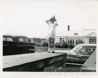 vintage photo Vernacular Snapshot Little Girl Sunglasses Stands on Wall