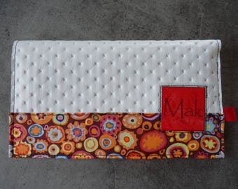 Dimpled checkbook and colorful patterns