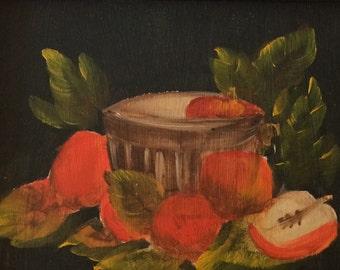 Framed still life with fruit on black background