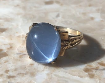 Synthetic phenomenon star cabochon and 14k gold ring