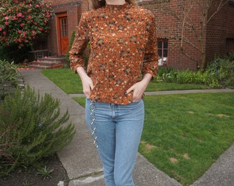 Rust colored floral silk blouse