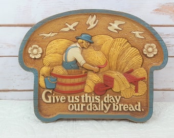 1986 Bread Loaf Give Us This Day Our Daily Bread Farmer Cutting Wheat Plastic Wall Hanging