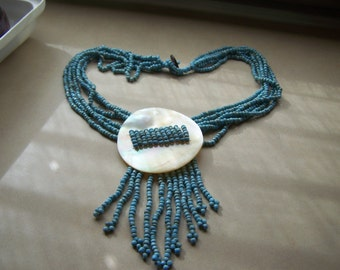 Hand Crafted Turquoise Multistrand Necklace with Mother of Pearl