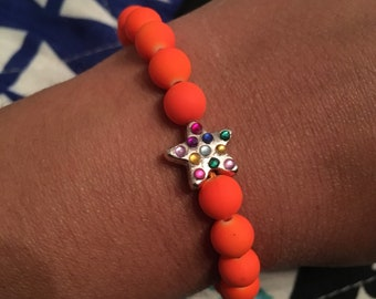 Rhinestone star charm and neon orange beaded bracelet