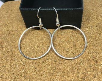 Sterling silver dangling hoop earrings