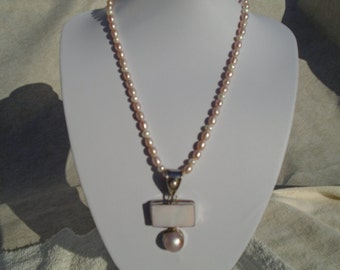Pink pendant and freshwater pearl necklace and earrings