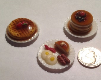 Miniature Breakfast waffles pancakes sausage bacon and eggs