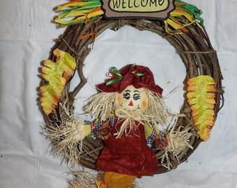 Grape vine wreath with Raffia Scarecrow - hsw3