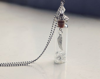 glass vial necklace with crystals and wing charm with light pink bead