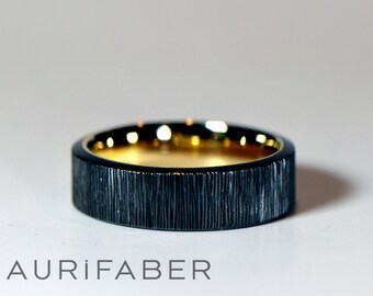 Zirconium ring with golden inside. Black zirconium ring and yellow gold, red rosé gold or white gold inside. 6mm wide band.