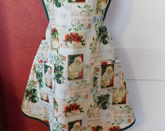 LADIES CHRISTMAS APRON --  pale blue/green with Santa, Noel, music notes - trimmed in dark green