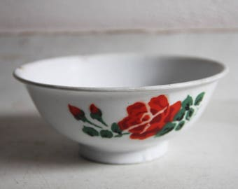 White enamel bowl with red roses