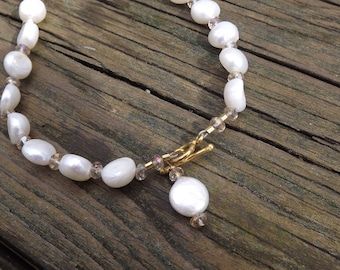 White Coin Pearl necklace with crystal beads.Necklace is lovely, very feminine.You can wear it with clasp at th