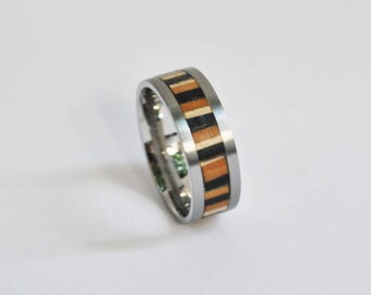 Metal and wood ring from recycled skateboards