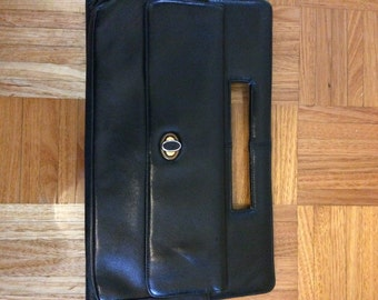 1960s black leather clutch