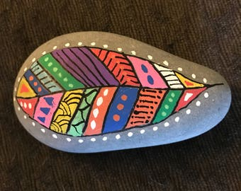 Feather painted rock