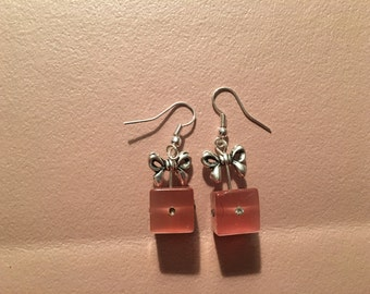 Earrings, dangle, pink gift box with silver bow on sterling silver hooks.