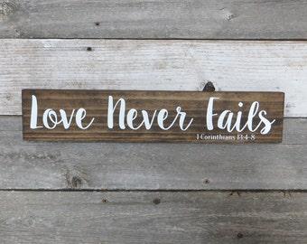 "Rustic Hand Painted Wood Sign ""Love Never Fails"" - I Corinthians 13:4-8 - 18""x3.5"" - Dark Walnut or Gray"