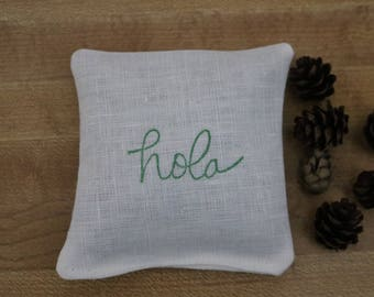 Balsam fir or lavender white linen sachet, hand stamped with fabric ink, hola in the color Cottage Ivy, Hello in Spanish, Spanish, Hola,