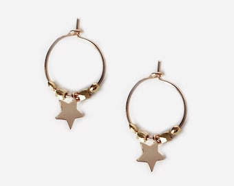 Gold plated earrings with little star