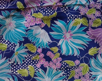 Bright bold 1960s floral dressmaking blue/multi fabric
