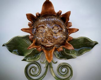 One of a kind ceramic wall sculpture of flower with face