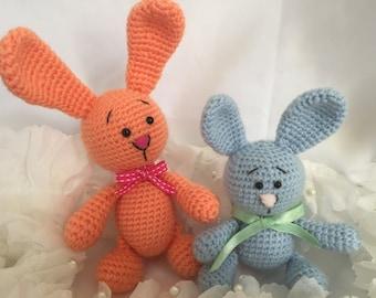 2 rabbits stuffed animals in crochet